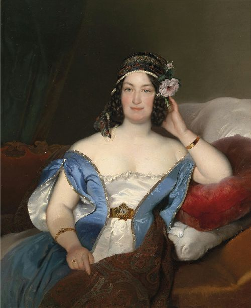 Portrait of a lady with richly decorated head dress and roses in her hair